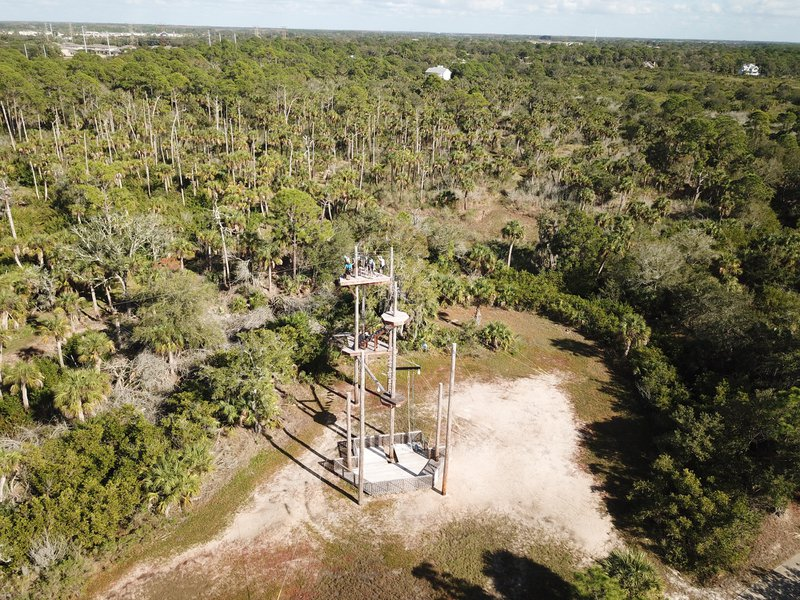 ziplining through Florida woods, aerial view